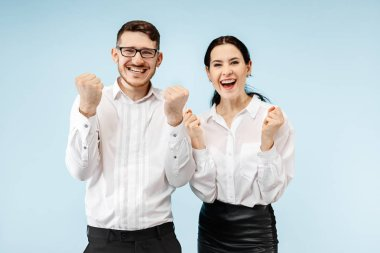 Excited happy young couple looking at camera with delight amazed by unbelievable great sale