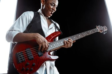 African American jazz musician playing bass guitar.
