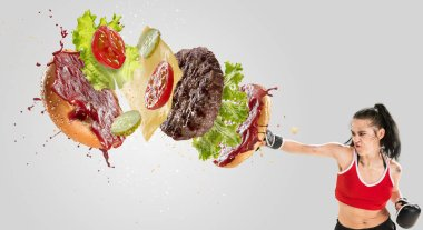 Fight the fast food. Burgers crashing by the boxer isolated on white background. Combination of buns, vegetables, sauce and cutlet is broken by sportswoman. Healthy eating, diet and sport concept. stock vector
