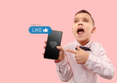 Social media interactions on mobile phone. Internet digital marketing, Chating, commenting, liking. Smiles and icons above smartphone screen, that holding by little boy on coral studio background. stock vector
