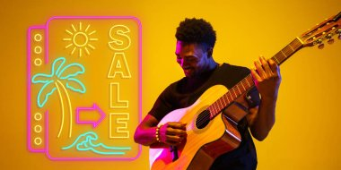 Young musician playing guitar in neon light on gradient background, inspired, artwork