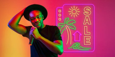 Young musician, party host singing, dancing in neon light