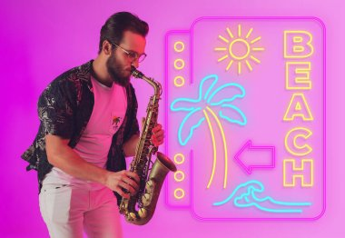 Young jazz musician playing the saxophone in neon light with neon sign