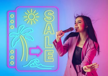 Caucasian female singer portrait isolated on gradient studio background in neon light with neon sign