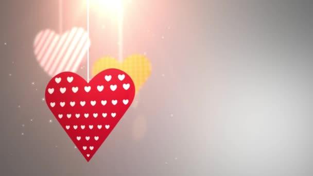 papíru Valentýnské srdce pádu dolů visící na řetězec bílé pozadí