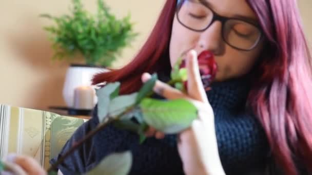Valentine Gift. Young Girl smelling on a red rose