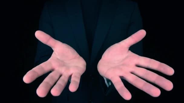 Business Man holding hands towards camera