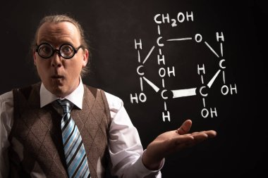Professor presenting handdrawn chemical formula of glucose