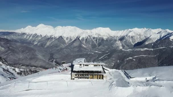 Krasnaya Polyana, Sochi. Mountains, snow, skiers, snowboarders, tourists. Vacation in the mountains. Clean air. Aerial photography with quadcopter.