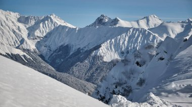 Beautiful snow-capped peaks of the Caucasus Mountains. Rosa Khutor Alpine Resort in Sochi. Russia.