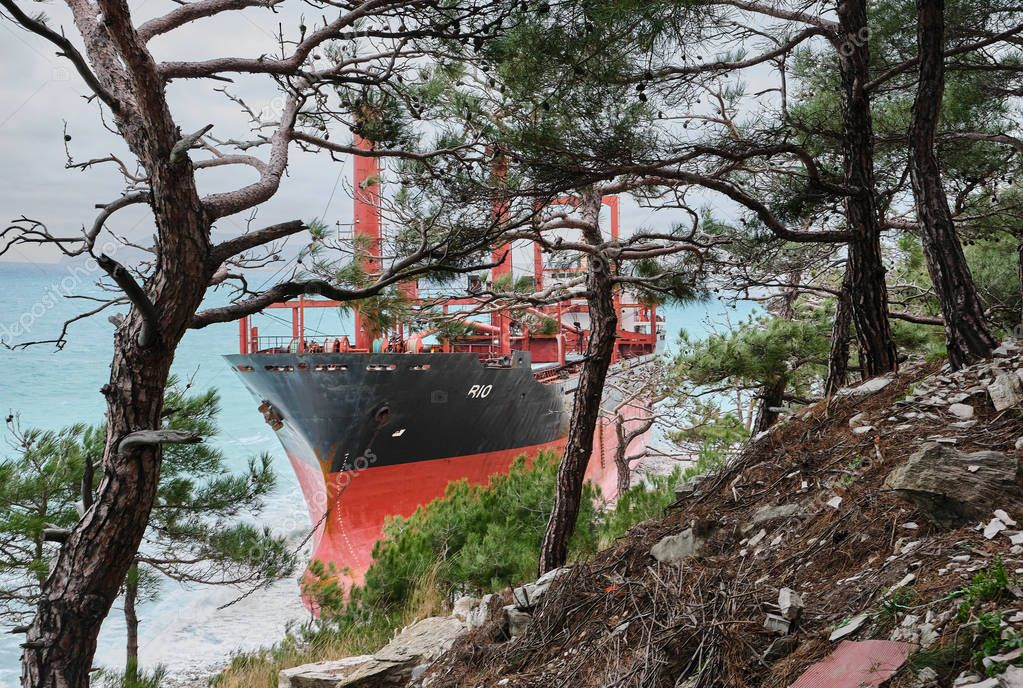 GELENDZHIK, RUSSIA - JAN 19, 2019: The ship called Rio ran aground after a storm in the black sea. The ship went to the port of Novorossiysk for loading