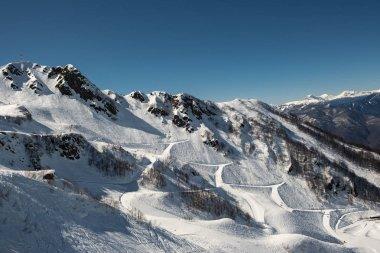 Ski resort Krasnaya Polyana in Sochi. Track for downhill skiers and snowboarders. Mount Aibga.