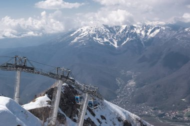 Aerial photography. Cable car to the top of the snow-covered mountain Aibga. Ski resort Krasnaya Polyana, Sochi. Vacation in the mountains. The view from the top.