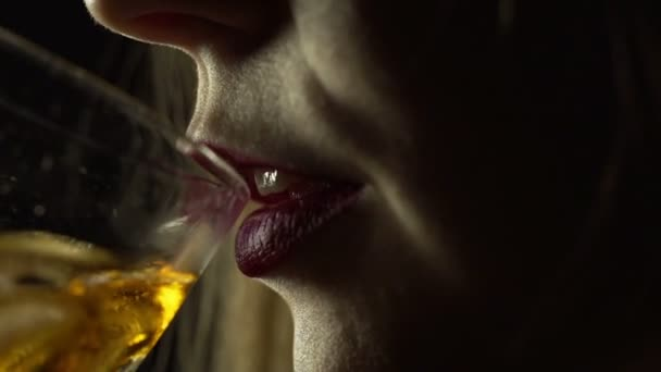 Portrait of a young woman drink whiskey