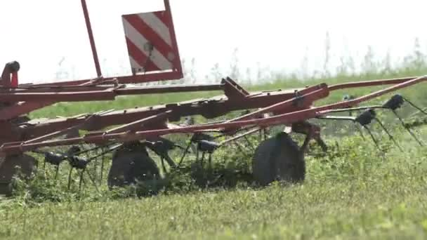 Farming tractor moving on agricultural field for harvesting land. Agricultural machinery on harvesting field