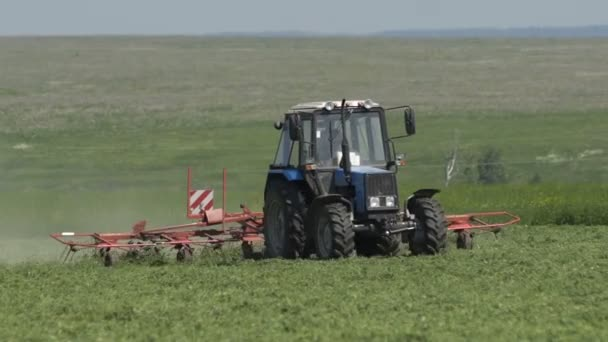 Harvesting herb with a farming tractor