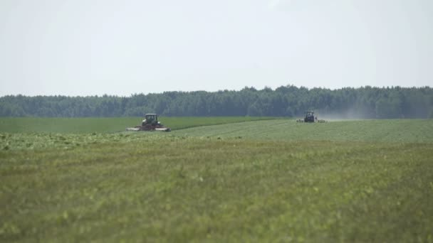 Farming combaine harvesters moving on agricultural field for harvesting land. Agricultural machinery on harvesting field