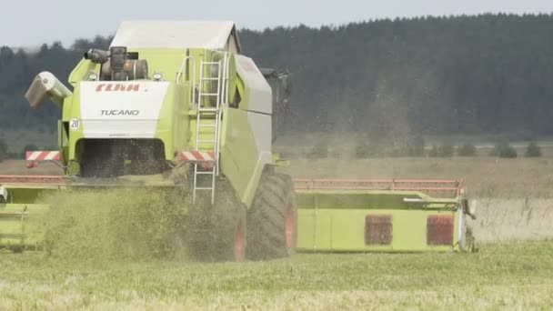 Slow motion shot of combine harvester. Harvest of field. Industrial background on agricultural theme