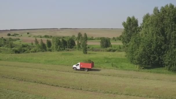 Aerial view of Truck moving on agricultural field. Agricultural machinery on harvesting field