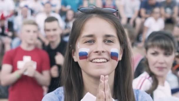 RUSSIA, Izhevsk - JUL 1, 2018: Russian Female football fan cheering at match football team in fan zone