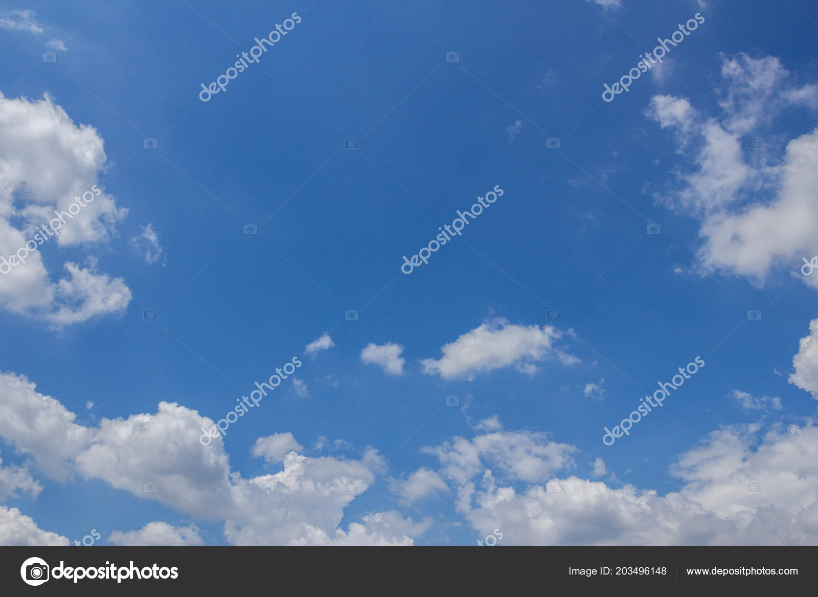 Charming Blue Sky Background With Fluffy Clouds That Frame The Sky. Panorama. Space  For Text. U2014 Foto De Germanopoli