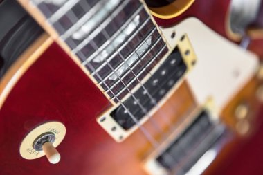 Six-string electric guitar closeup. Vintage style.