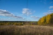 Photo Panorama of Klin-Dmitrovsky ridge with villages and high voltage line in autumn, Sergiev Posad district, Moscow region, Russia