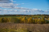 Photo Panorama of Klin-Dmitrovsky ridge with villages in autumn, Sergiev Posad district, Moscow region, Russia