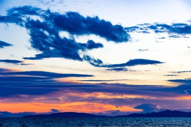 Sunset in Follonica in late winter with cloudscape and shades of