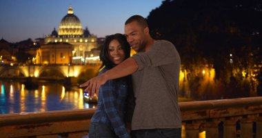 Vacationing African-American couple enjoys the sights in Rome near Vatican City
