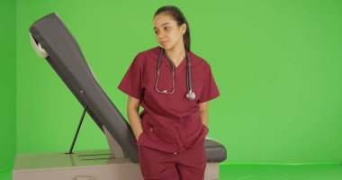 A doctor stares off into the distance on green screen