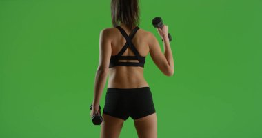 Hispanic girl lifting dumbbells with back to camera out on green screen
