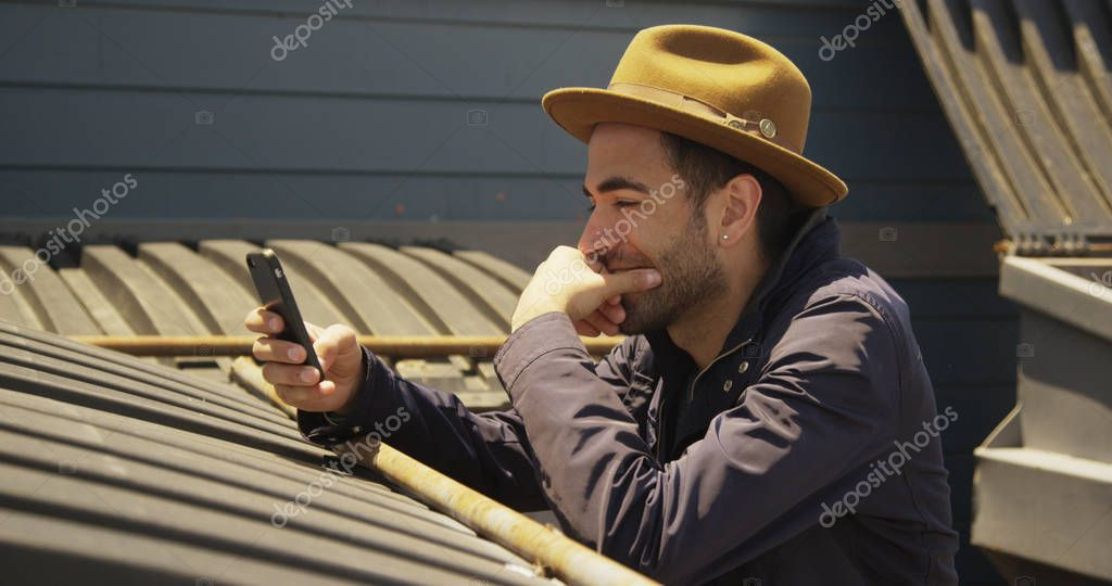 Young Hipster using smartphone outdoors