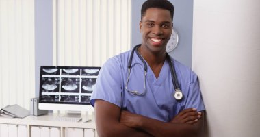 Portrait of black male medical doctor in hospital