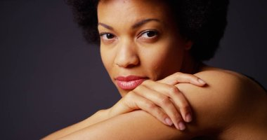 Attractive black woman with afro looking at camera