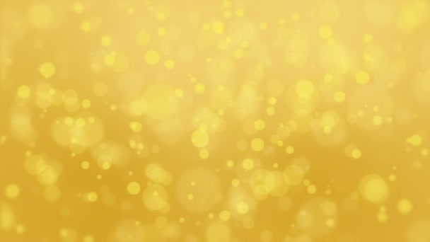 Glowing yellow gold bokeh background with floating light particles.