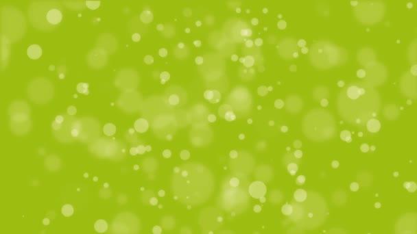 animierter lindgrüner Hintergrund mit schwebenden Bokeh-Lichtern.