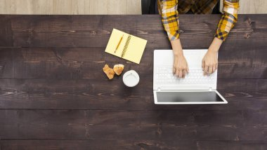Businesswoman Working At Notebook