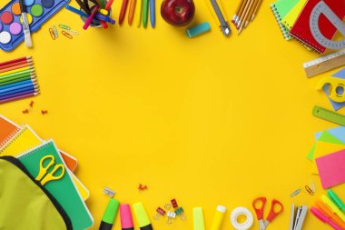 School supplies on yellow background. Back to school concept