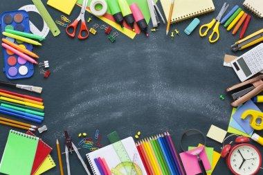 School supplies on blackboard. Back to school concept