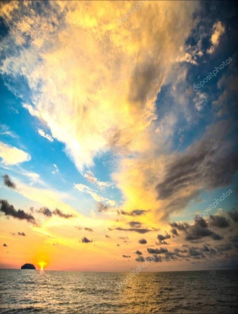 Breaking dawn is the first apperance of golden ray light in the sky before sunrise. The golden ray is an overwhelmingly impressive, breathtaking. Its so majestically mind-blowing moments of a natural phenomenon in a quiet beach of Sabah Malaysia.