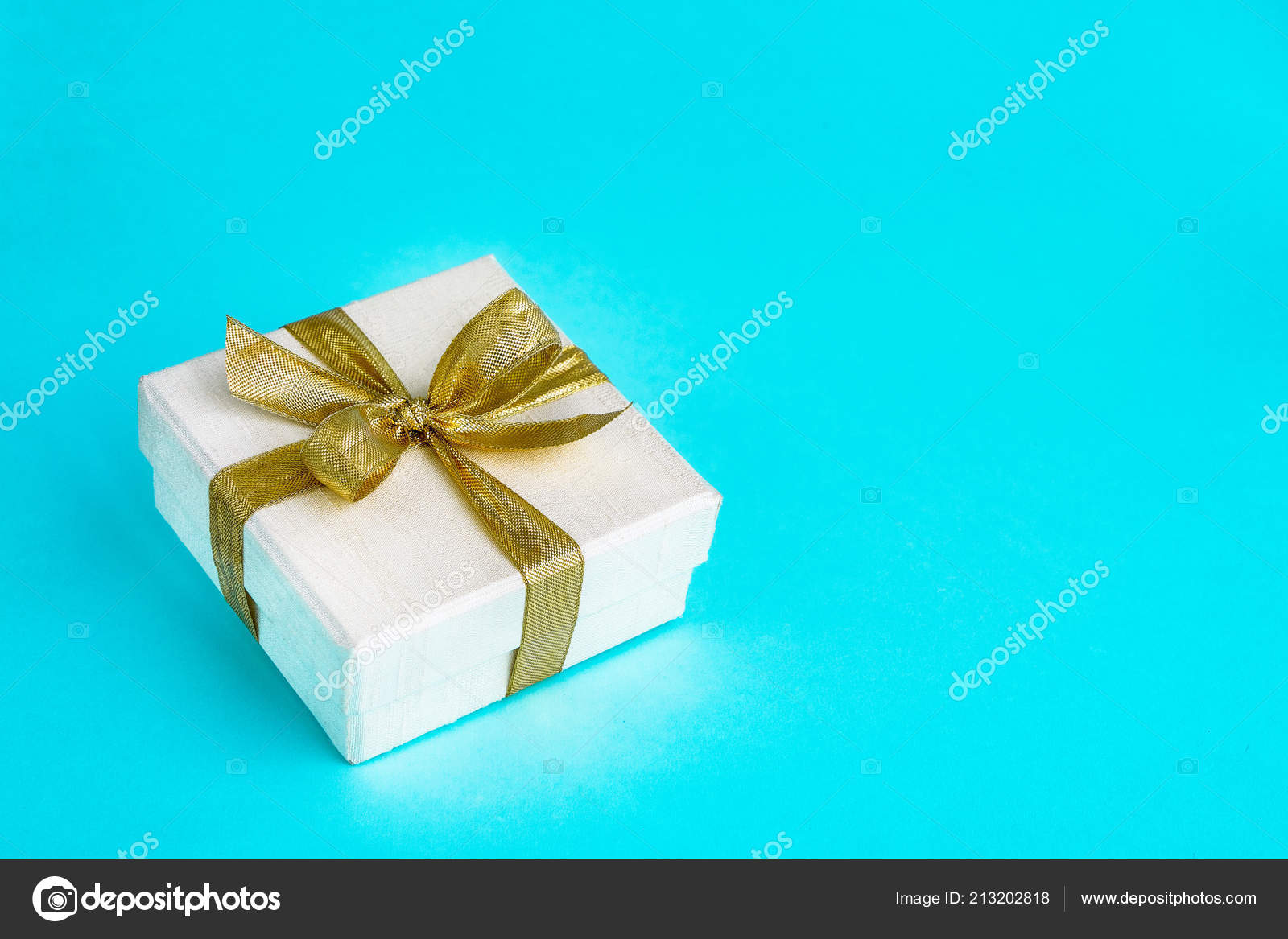Gift Or Present Box Decorated With Golden Ribbon On Blue Background Top View Copy Space Birthday Mothers Day Wedding Valentine Concept