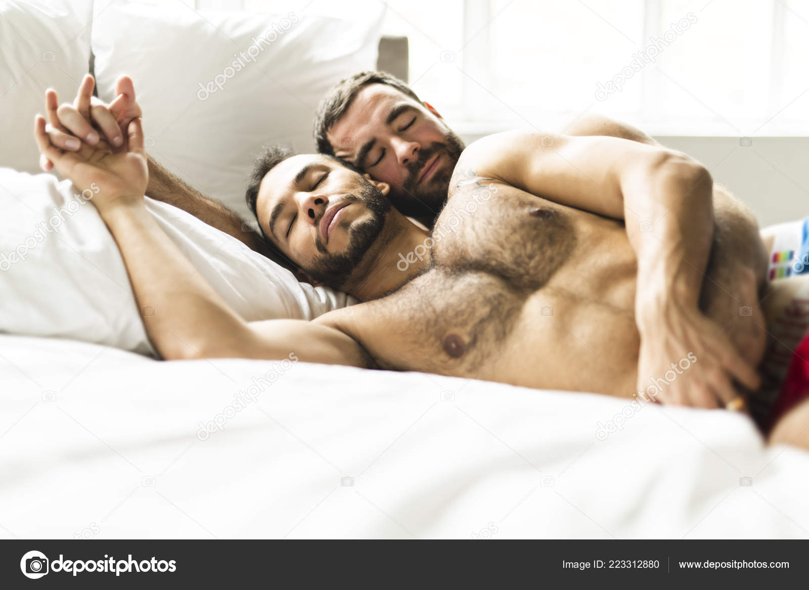 Gay men together bed