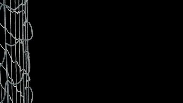 Fotbalový míč vstřelí gól na černém pozadí