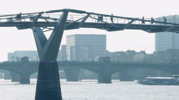 People Crossing Foot Bridge In The City