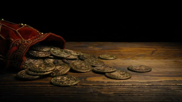 Bag Of Coins On Wooden Table