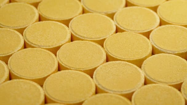 Passing Rows Of Vitamin Pills Closeup