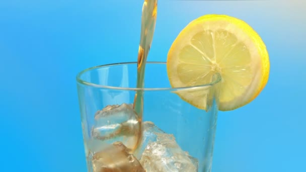 Cola Drink Pours Into Glass With Lemon Slice