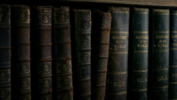 Passing Old Leather Bound Books On Shelf