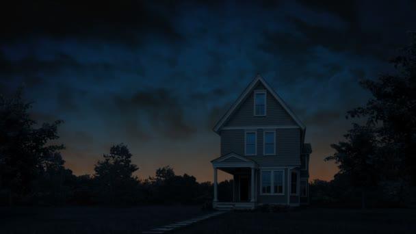 Haus bei Tagesanbruch mit orangefarbenem Himmel